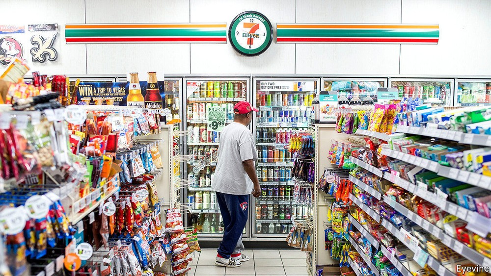 seven eleven store inside with a shopper with red cap